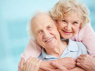 assisted living services with family member giving hugs