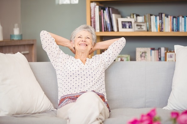 care connections of cincinnati with happy woman on couch after senior care referral agency help