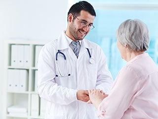 doctor suggesting elderly care solutions to an older female patient