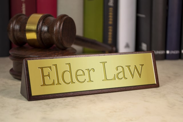 elder law attorney desk name plate and gavel
