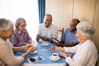 elderly group in social interaction in assisted living communities