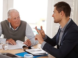 elderly person trying to understand comparison of durable power of attorney vs living will