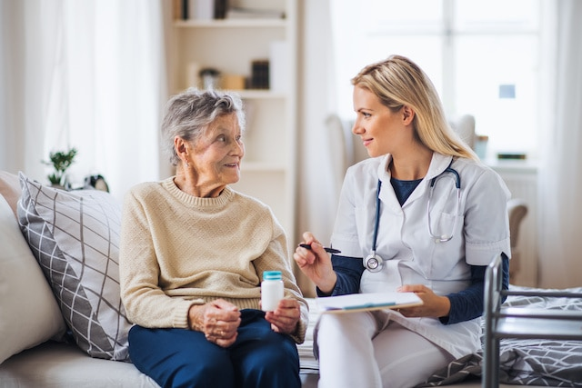 elderly woman using questions to ask a home health care provider