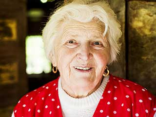 happy senior woman enjoying quality elderly care