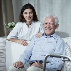 nurse helping man in elderly home care after senior placement services with eldercare connections
