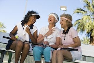 senior housing image of three women enjoying say outside in senior living communities